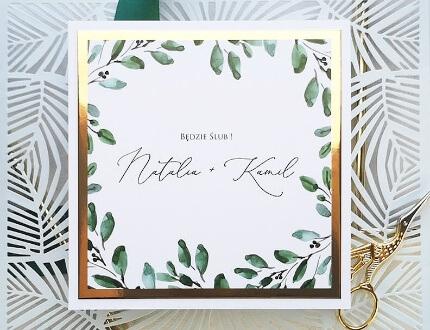 Oryginalne zaproszenie łączące kolor złoty z zielonym.